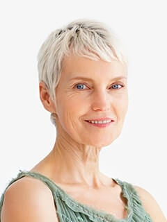 An older woman showing how dental implants enhance your smile