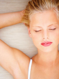 A woman fully relaxed thanks to sedation dentistry