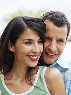 A smiling couple shows how dental bonding can improve your smile